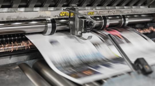 Printing press printing a newspaper