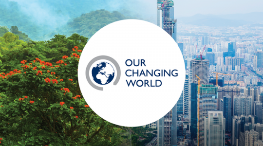 Our changing world poster text and logo on with city skyscrapers in the background